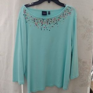 Light turquoise top.